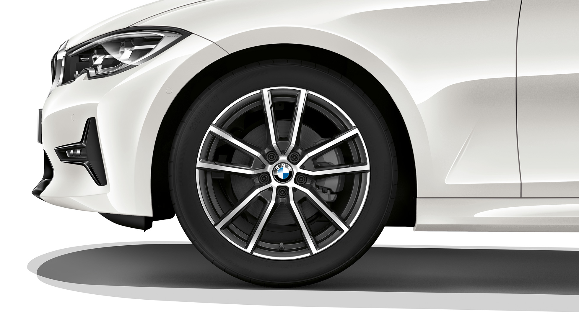 Close-up of the light alloy wheel of the BMW 3 Series Saloon with Model Sport Line equipment.