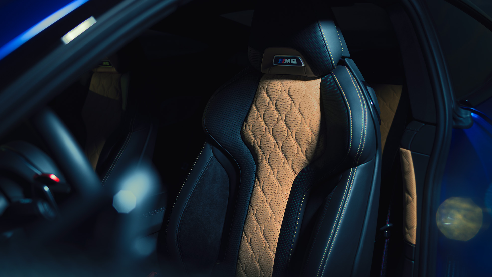 BMW M8 Competition Coupé, M Sport seat with M8 badge and upholstery in full leather 'Merino' Black with contrast Midrand Beige.