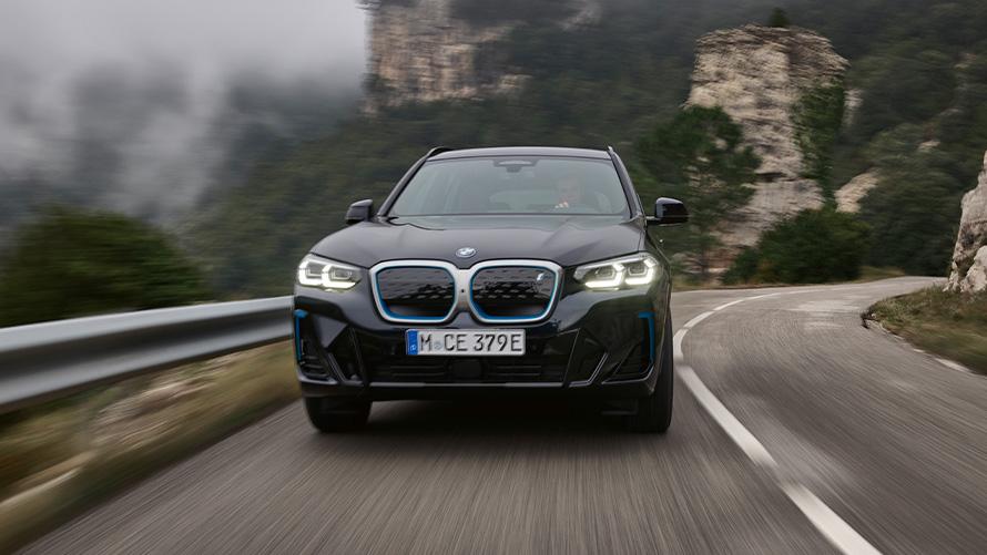 BMW iX3 G08 2021 M Carbon Black side front view driving