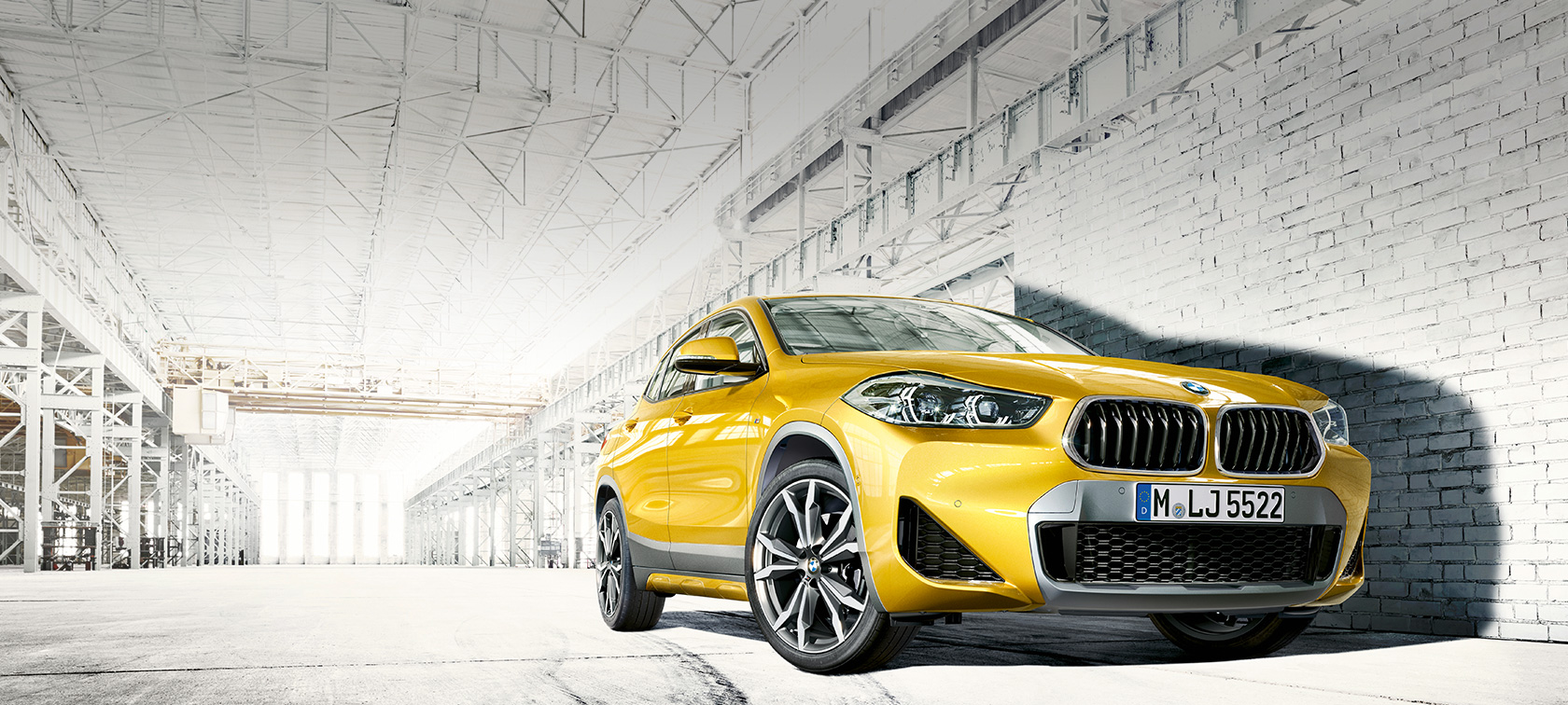 Three quarter front view BMW X2 2018 F39 Galvanic Gold metallic