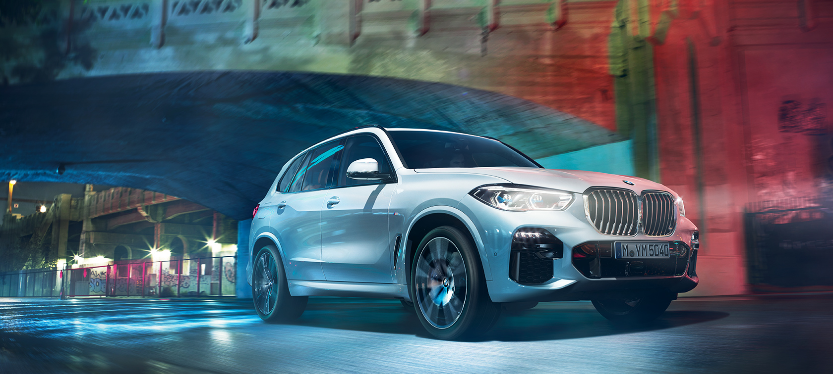 The Bmw X5 Travelling Through City At Night