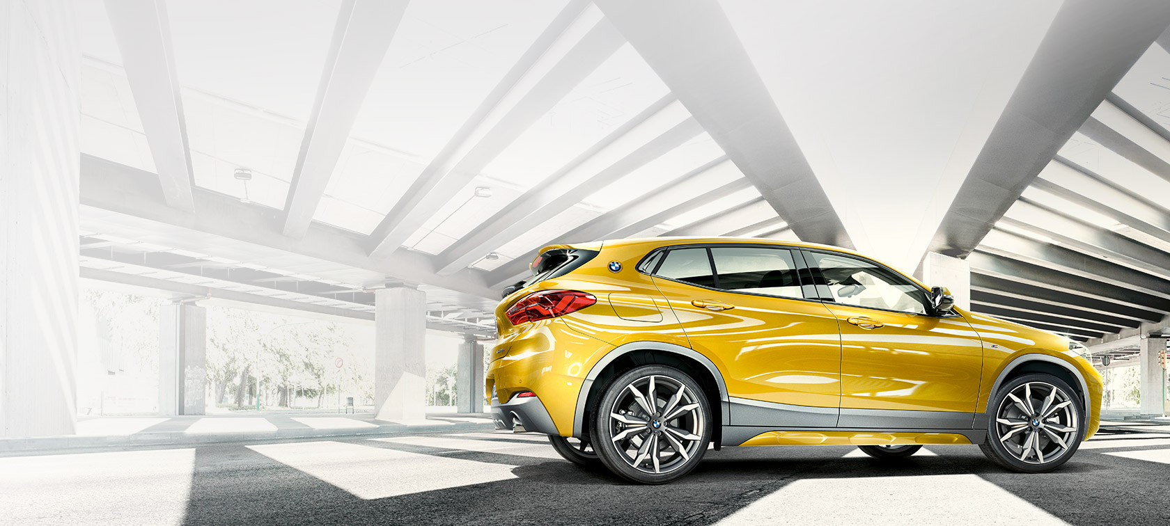 BMW X2 2018 F39 Galvanic Gold metallic side view