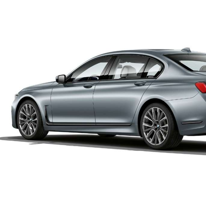 Grey BMW 7 Series Saloon M Sport package in three-quarter rear view