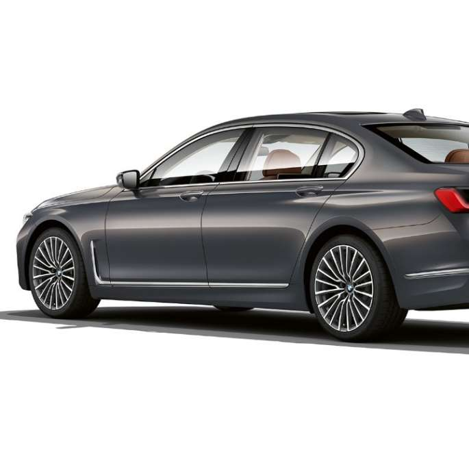 Grey BMW 7 Series Saloon with Exterior Design Pure Excellence in three-quarter rear view